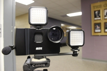 iPhone 5 in Camlite case, mounted on tripod with lights attached to accessory shoes.
